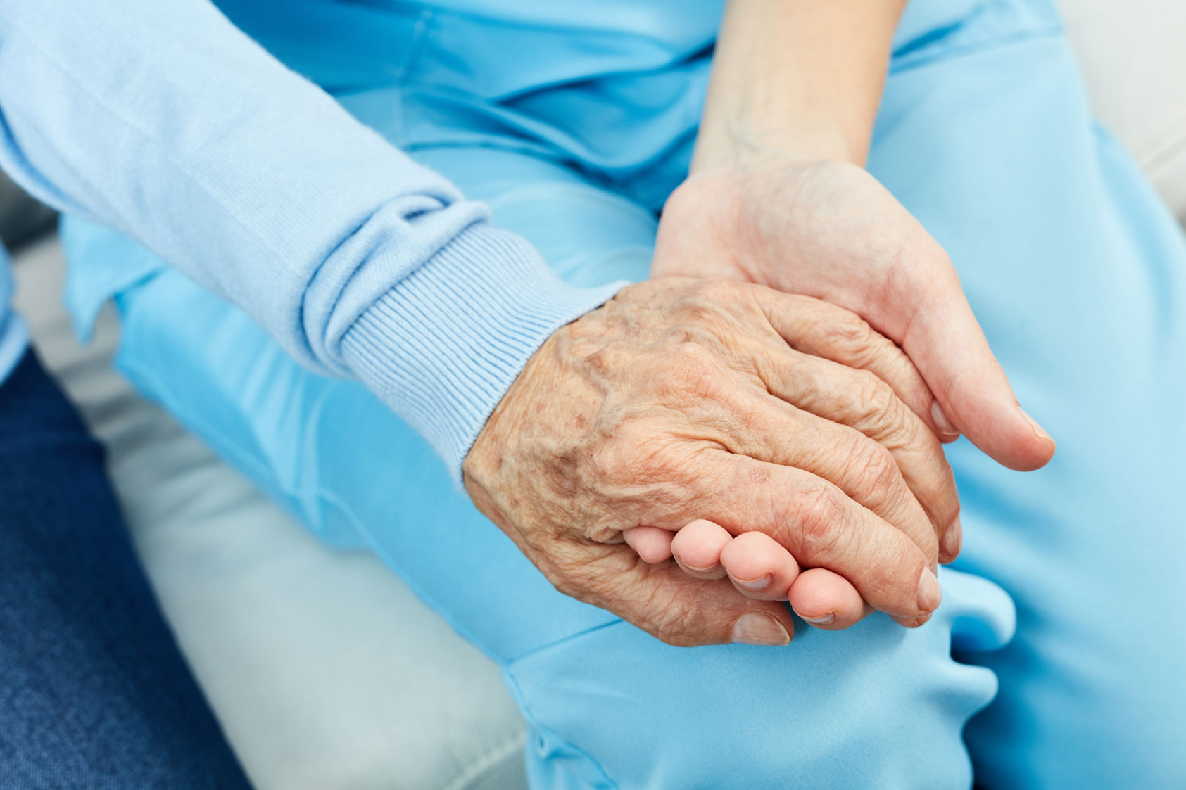 Nurse holding patients hand
