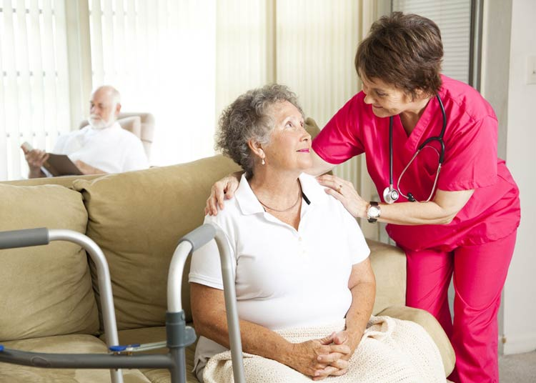 Nurse helping patient in Respite Care
